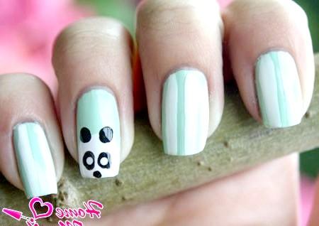 Фото - малюнок панди на безіменному пальці