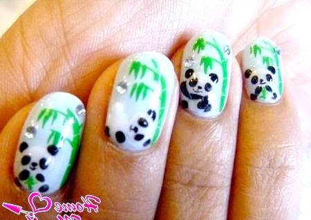 Фото - оригінальний дизайн нігтів з пандами