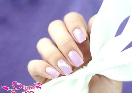 Фото - елегантний бантик на нігтях стемпинг Конад