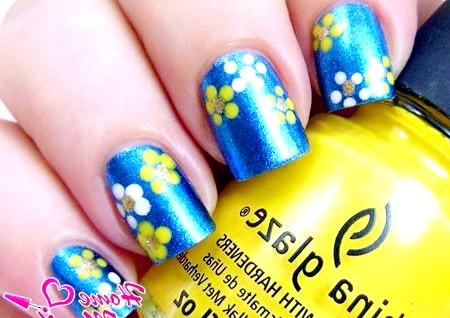 Фото - малюнки квітів на нігтях ДОТС