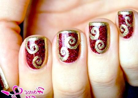 Фото - розкішне золото на червоних нігтях