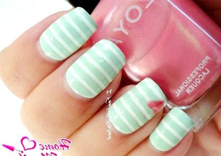 Фото - ніжний м'ятний дизайн нігтів в смужку