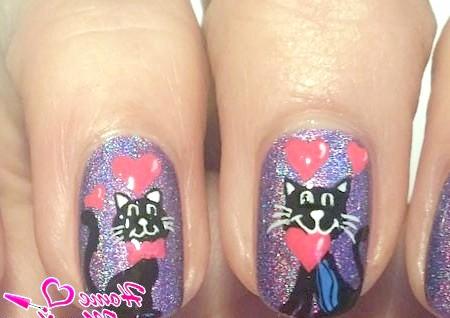 Фото - закохані кіт і кішка на нігтях