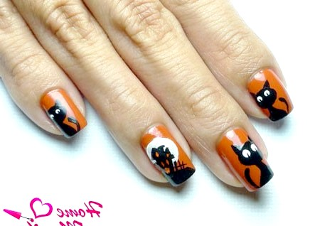 Фото - гарний дизайн нігтів з чорними кішками