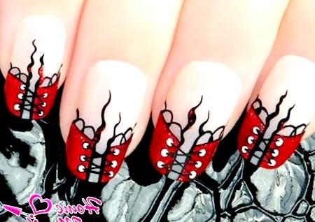 Фото - дизайн нігтів з сексуальними червоними корсетами