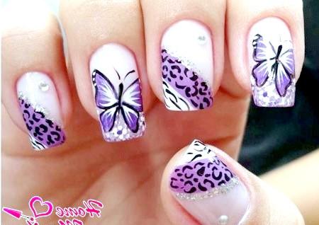 Фото - малюнок метелики і тваринний принт на нігтях
