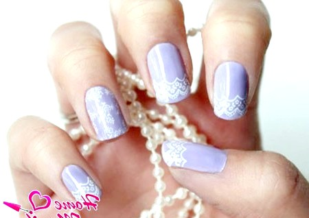 Фото - ніжне мереживо на блідо-фіолетових нігтях