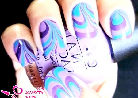 Фото - водний манікюр в синьо-фіолетових тонах